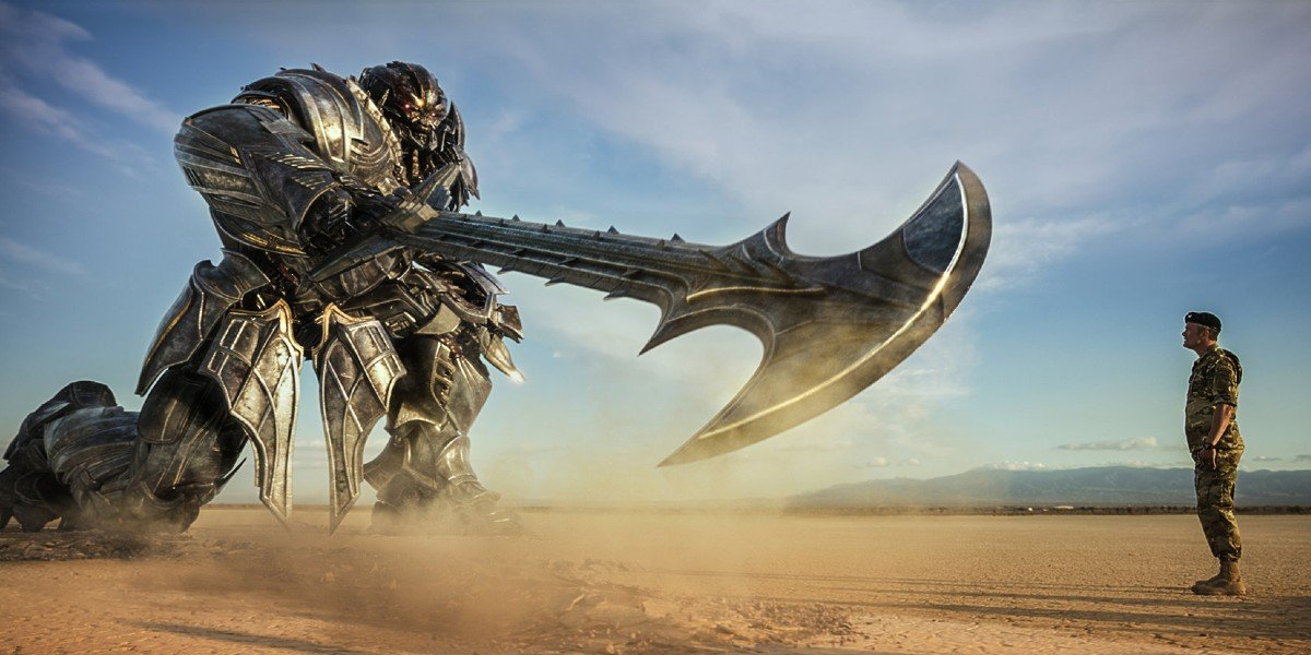 Transformer holding giant sword at human