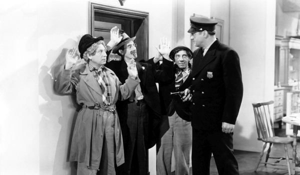 Groucho Harpo and Chico at gunpoint of police officer in The Big store