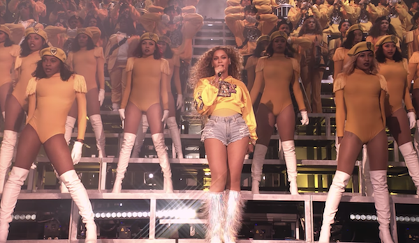 Beyonce and dancers on stage at Coachella 2018 in homecoming