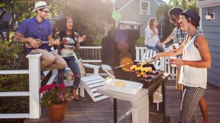 Gas vs charcoal grill: image of group of people at cookout