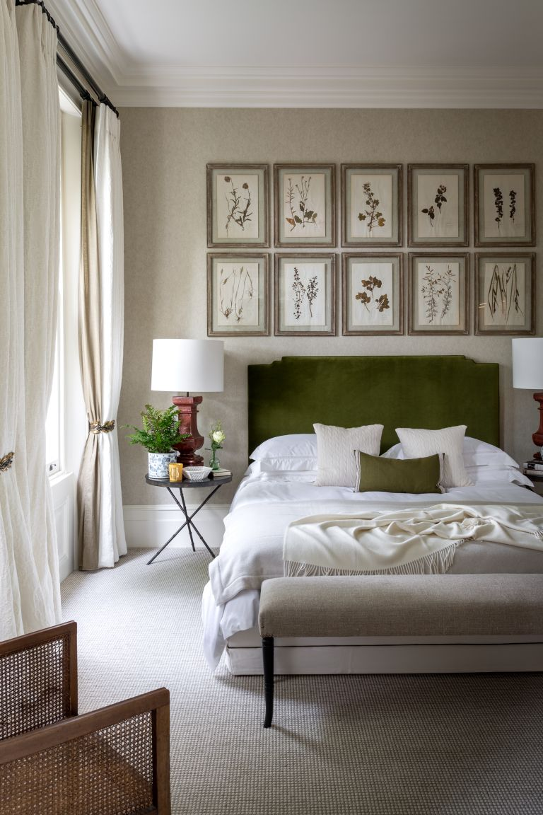 botamical art prints above bed in bedroom by Kitesgrove