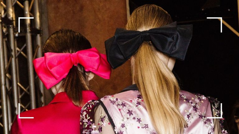 how to get shiny hair main image of backstage shot of models hair in shiny ponytail