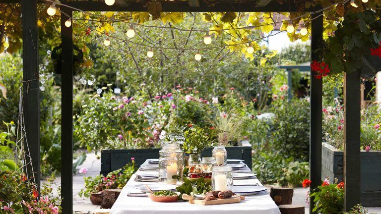 pergola lighting ideas lights4fun festoons over outdoor dining table