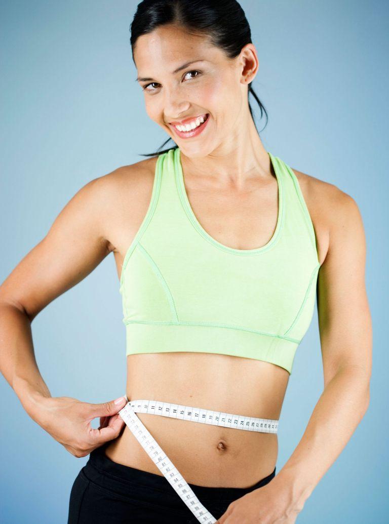 woman measuring waist photo