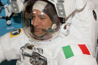 Clad in a white spacesuit with his country's green, white and red flag decorating his left shoulder, Luca Parmitano emerged from the International Space Station to become Italy's first astronaut to walk in space on July 9, 2013.