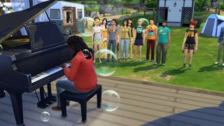 A Sim version of Joy Oladokun plays the piano on a stage while a group of Sims watch
