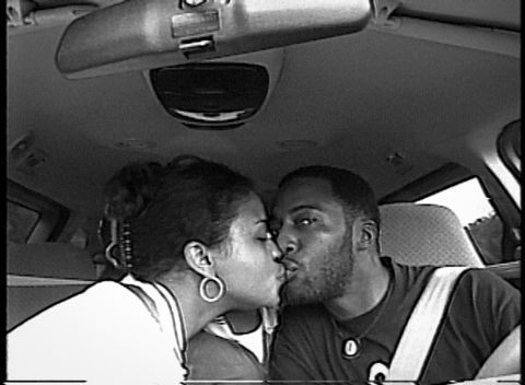 Sibil Fox Richardson and Rob Richardson kiss in their car.