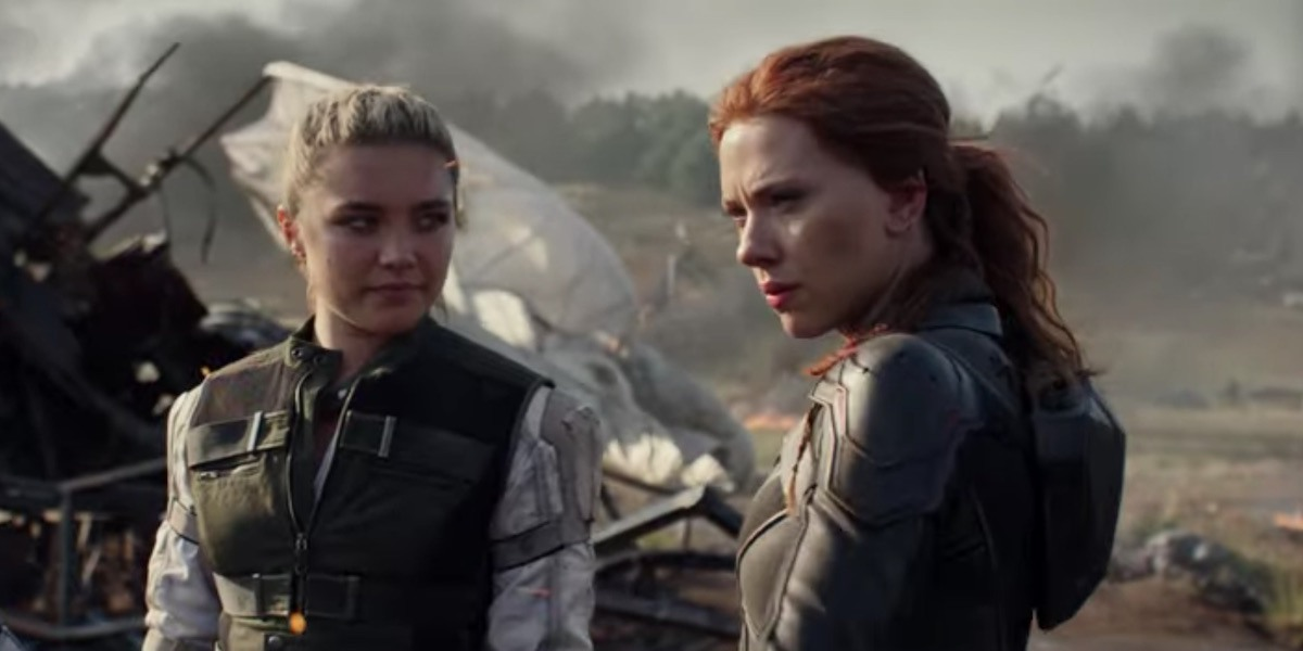 Black Widow Florence Pugh and Scarlett Johansson stand amid some wreckage