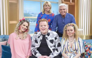 Rosie, Craig and Gemma on the This Morning sofa, with presenters Holly and Phil standing behind them