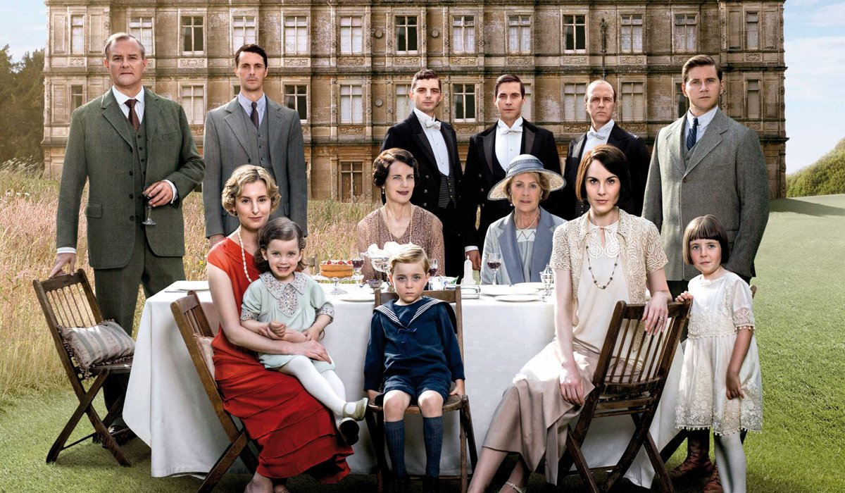Downton Abbey cast seated on lawn PBS