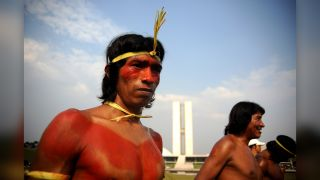 A Xavánte man in Brazil, just after the traditional logs race that was part of the Native Peoples Meeting in September 2012. The Xavánte people were included in a new study about the genetic connection between people in South America and Oceana.