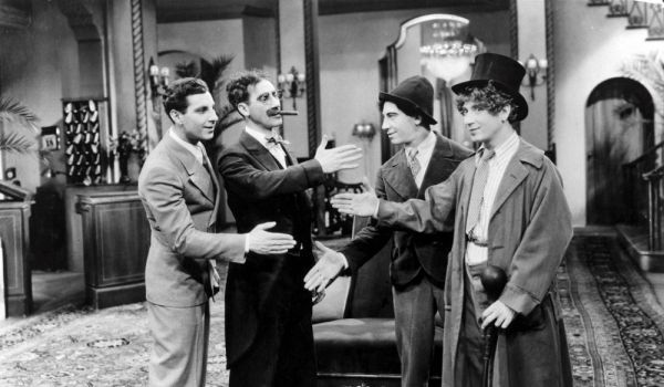 All four Marx Brothers trying to shake hands with each other