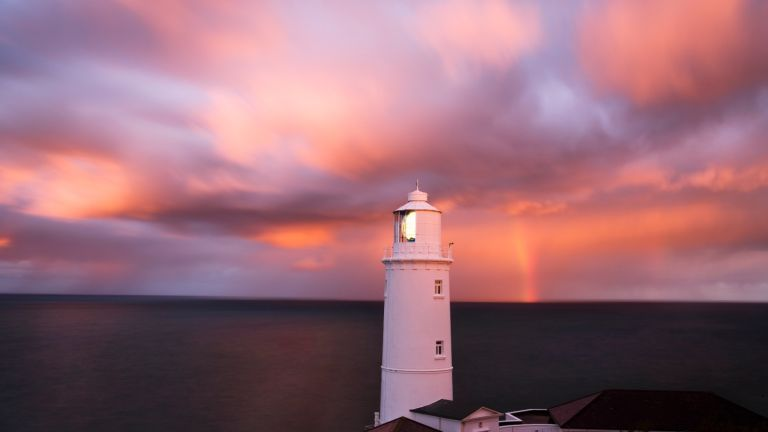Trevose Head Lighthouse at sunset, one of our picks for the best UK lighthouses