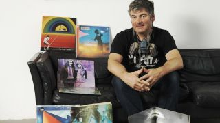 street artist and Pure Evil gallery own Charles Uzzell-Edwards with his record collection