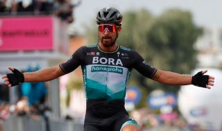 Team Bora-Hansgrohe rider Slovakias Peter Sagan celebrates as he crosses the finish line in the 10th stage of the Giro dItalia 2020 cycling race a 177kilometer route between Lanciano and Tortoreto on October 13 2020 Photo by Luca Bettini AFP Photo by LUCA BETTINIAFP via Getty Images