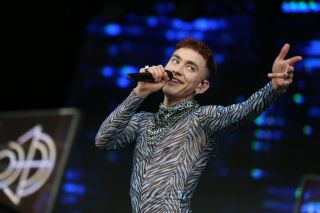 Olly Alexander performing on stage.