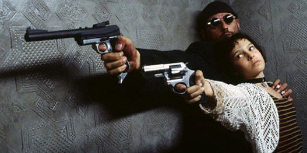 Leon 9Jean Reno) teaches Mathilda (Natalie Portman) to be a killer in Leon: The Profesional