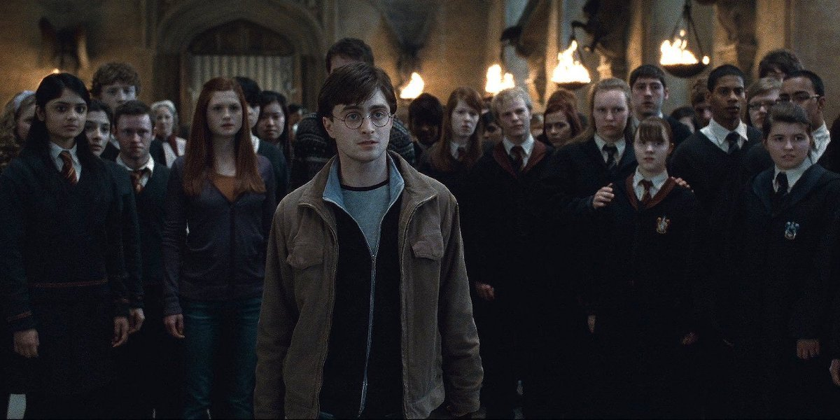 Harry Potter stands in front of his fellow Hogwarts students in the Great Hall in 'Harry Potter and