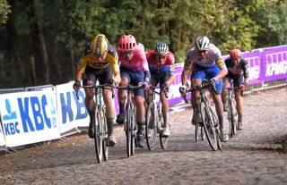 WEVELGEM BELGIUM OCTOBER 11 Wout Van Aert of Belgium and Team Jumbo Visma Alberto Bettiol of Italy and Team EF Pro Cycling Mathieu Van Der Poel of The Netherlands and Team AlpecinFenix Florian Senechal of France and Team Deceuninck QuickStep Breakaway Cobblestones during the 82nd GentWevelgem In Flanders Fields 2020 Men Elite a 2325km race from Ypres to Wevelgem GentWevelgem FlandersClassic on October 11 2020 in Wevelgem Belgium Photo by Luc ClaessenGetty Images