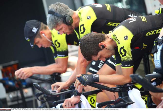 The riders from Mitchelton Scott warm up