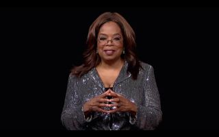 Oprah Winfrey honors Governors Award recipient Tyler Perry.