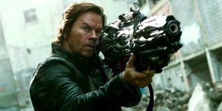 Mark Wahlberg holding a huge gun