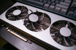A close up of a modern GPU Graphic card unit heatsink with active fan for thermal solution S By