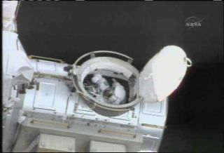Spacewalkers Test Shuttle Boom for Heat Shield Repairs
