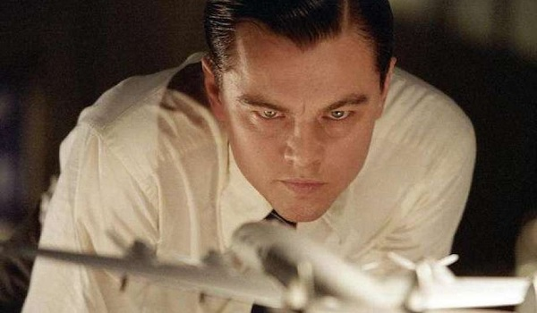 The Aviator Leonardo DiCaprio Howard Hughes studies a model of his latest airplane