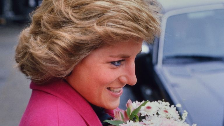 A smiling Diana, Princess of Wales receiving a bouquet of flowers during a visit to the Relate Marriage Guidance Centre in Barnet, north London, 29th November 1988