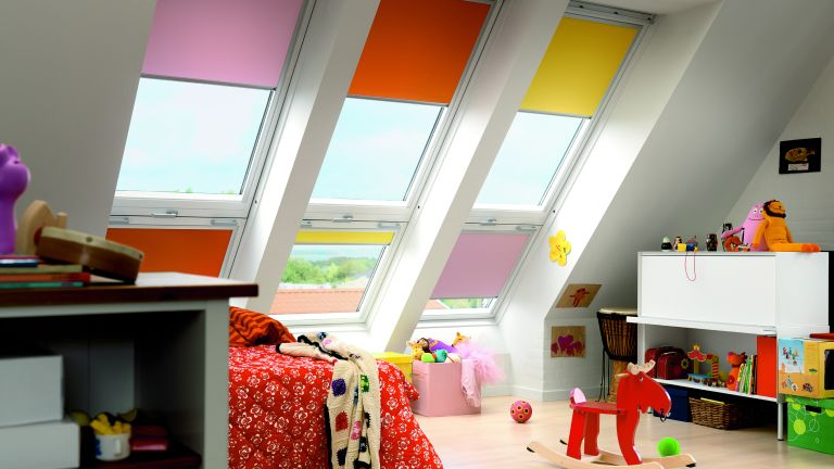 Colourful loft and child's bedroom with blinds at windows by Hillarys