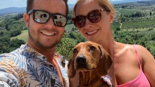 Spoiled dog: image of Louis Miniature Dachshund with owners