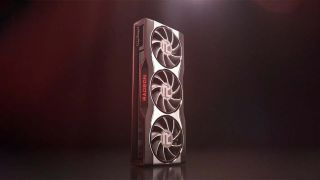 An AMD Radeon Graphics Card With Three Fans Standing Upright Against A Dark Red Backdrop