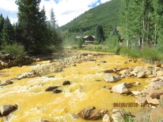 Photo of Cement Creek in Silverton, Colorado, after the Gold King Mine contaminated it with toxic water.