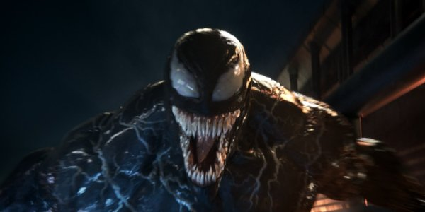 Venom smiles at the camera, jaws wide open