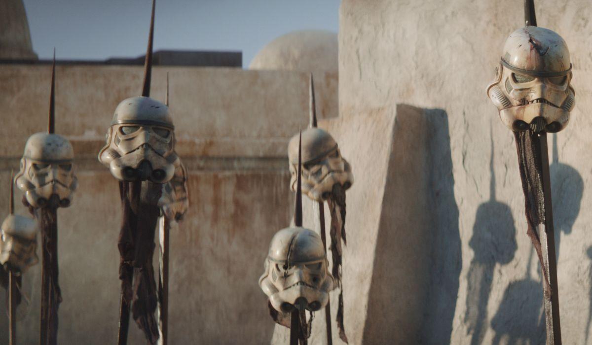 Storm trooper helmets on spikes in The Mandalorian