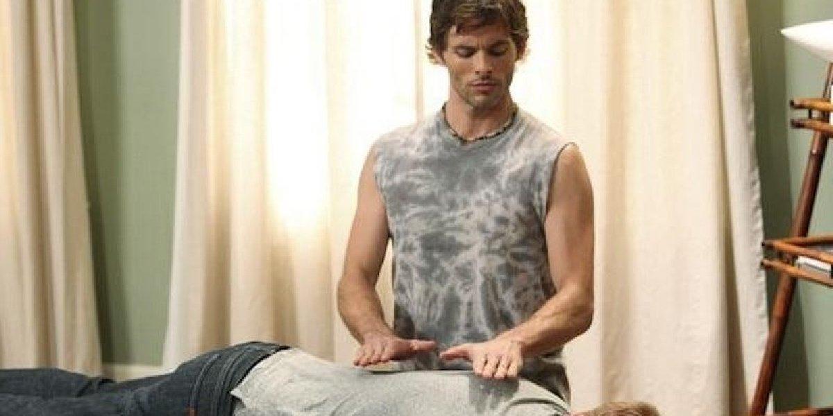 James Marsden as Barry massaging someone in Modern Family.