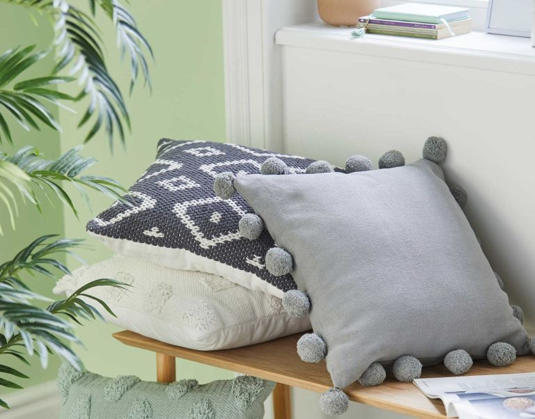 Aldi grey pom pom cushion