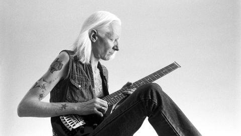 Johnny Winter playing the guitar