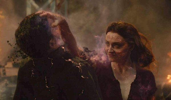 Dark Phoenix Jean Grey grabs Magneto and starts to burn him inside out