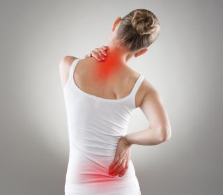 A woman has pain in her neck and back