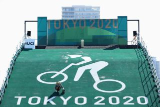 TOKYO JAPAN JULY 19 A worker paints the start ramp at the Cycling BMX racing venue at the Ariake Urban Sports Park ahead of the 2020 Tokyo Summer Olympic Games on July 19 2021 in Tokyo Japan The Ariake Urban Sports Park will host skateboarding and BMX cycling events Photo by Cameron SpencerGetty Images
