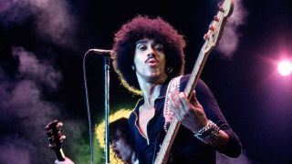 Thin Lizzy frontman Phil Lynott playing his bass on stage