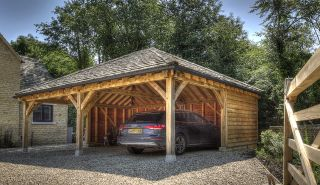 This spacious oak frame car port was designed and supplied by Made in Oak