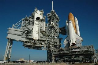 Shuttle Discovery Treks to Launch Pad for Next Mission