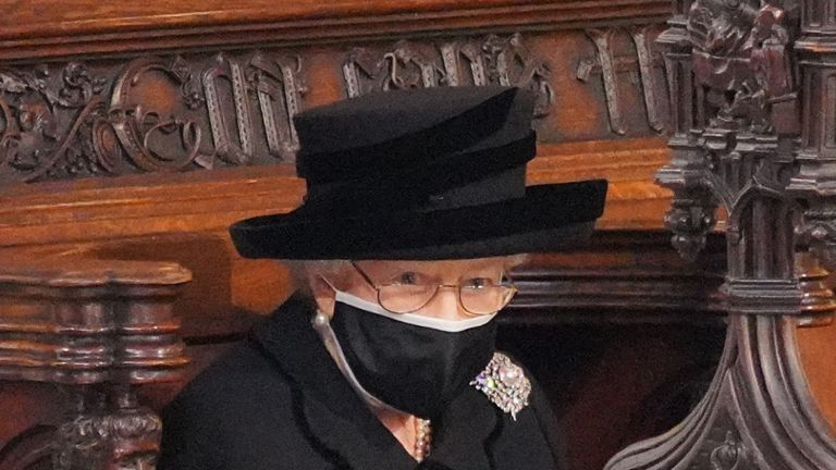 WINDSOR, ENGLAND - APRIL 17: Queen Elizabeth II takes her seat during the funeral of Prince Philip, Duke of Edinburgh, at St George's Chapel at Windsor Castle on April 17, 2021 in Windsor, England. Prince Philip of Greece and Denmark was born 10 June 1921, in Greece. He served in the British Royal Navy and fought in WWII. He married the then Princess Elizabeth on 20 November 1947 and was created Duke of Edinburgh, Earl of Merioneth, and Baron Greenwich by King VI. He served as Prince Consort to Queen Elizabeth II until his death on April 9 2021, months short of his 100th birthday. His funeral takes place today at Windsor Castle with only 30 guests invited due to Coronavirus pandemic restrictions. (Photo by Jonathan Brady - WPA Pool/Getty Images)