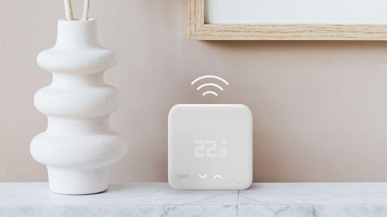 Tado smart thermostat on a marble shelf