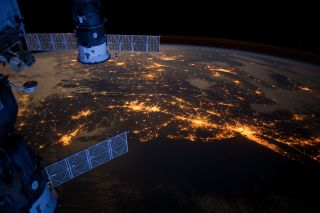 A member of the International Space Station's Expedition 30 crew snapped this nighttime image of the Atlantic coast of the United States on Feb. 6, 2012. Parts of two Russian spacecraft parked at the orbiting outpost can also be seen in the left foregroun