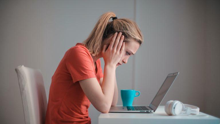 Laptop user looking worried