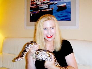 Reptile devotee Taryn Hook with Larry the boa constrictor.